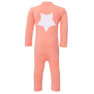 Petit Crabe coral Lou sunsuit with star application on the back. UV sun protective swimwear for kids.