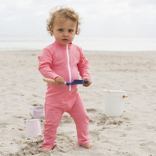 Petit Crabe baby girl in watermelon Lou ICE CREAM sunsuit with zipper and long sleeves. UV sun protective swimwear for kids.
