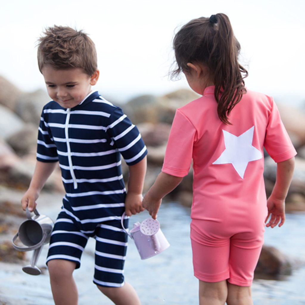 Petit Crabe Boy In Blue And White Striped Natsu Sunsuit And Girl In Noe STAR Sunsuit. Sun Protective Clothing For Kids.