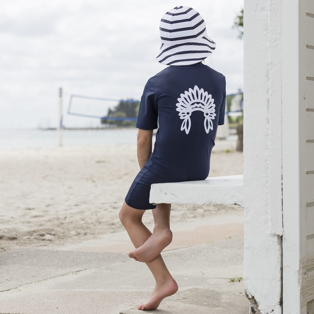 Petit Crabe blue Noe sunsuit with chief application and stribed sun hat. UV sun protective swimwear for kids.