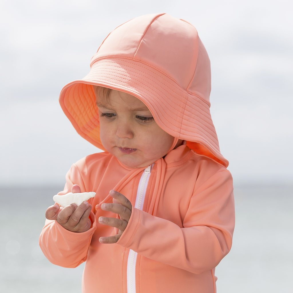 Petit Crabe coral Frey sun hat and Etoile swim shirt for baby girls. UV sun protective swimwear for kids.