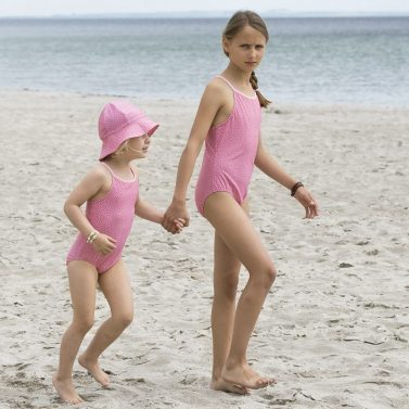 Petit Crabe pink flower Barbara swimsuits for girls. UV protective swimwear for children.