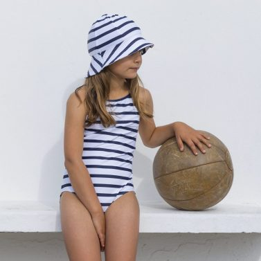 Petit Crabe white and blue striped Barbara swimsuit and sun hat for girls. UV sun protective swimwear.