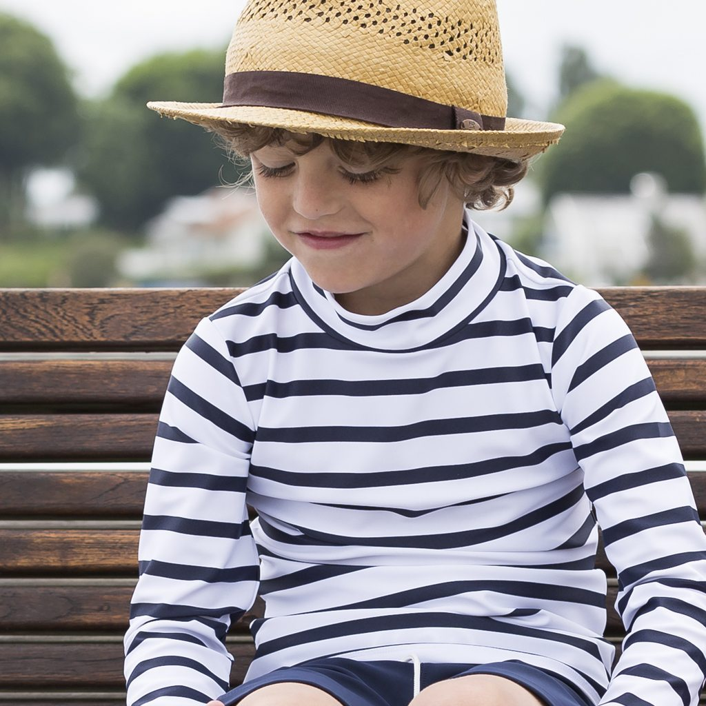 Petit Crabe boy white and blue striped Casey turtleneck rash guard. UV sun protective swimwear for kids.