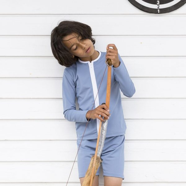 Petit Crabe boy with petrol blue Etoile Zipper swim shirt with slong sleeves and zipper. UV sun protective swimwear for kids.