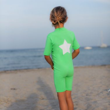 Petit Crabe apple green Noe star sunsuit for kids, girl in sun protective clothing, Back
