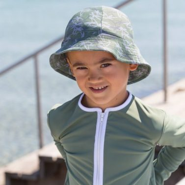 Petit Crabe Boy in Palms print Frey sunhat, sun protective clothing for kids.