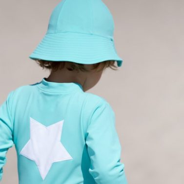 Petit Crabe in Turquoise Frey Sun Hat & Lou STAR sunsuit, sun protective swimwear for kids.