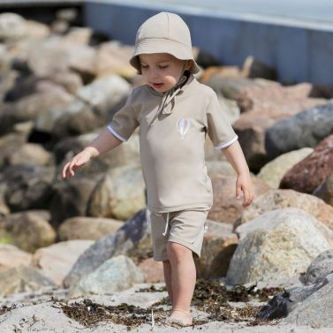 Petit Crabe cappuccino Frey sunhat and rash guards for kids, boy in uv protective clothing