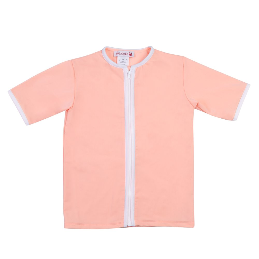 Petit Crabe peach Salo rash guard with short sleeves and zipper. UV sun protective swimwear for kids.
