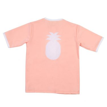 Petit Crabe peach Salo rash guard with pineapple application. UV sun protective clothing for kids.