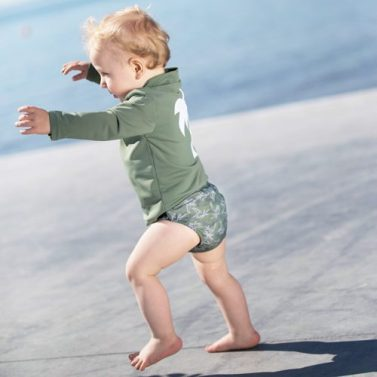 Petit Crabe Baby boy in Leo swim nappy with palm print & Casey PALM turtleneck rash guard