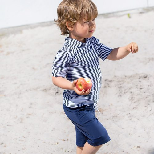 Petit Crabe pencil striped Ash rash guard and blue board shorts with pockets. UV sun protective clothing for kids.
