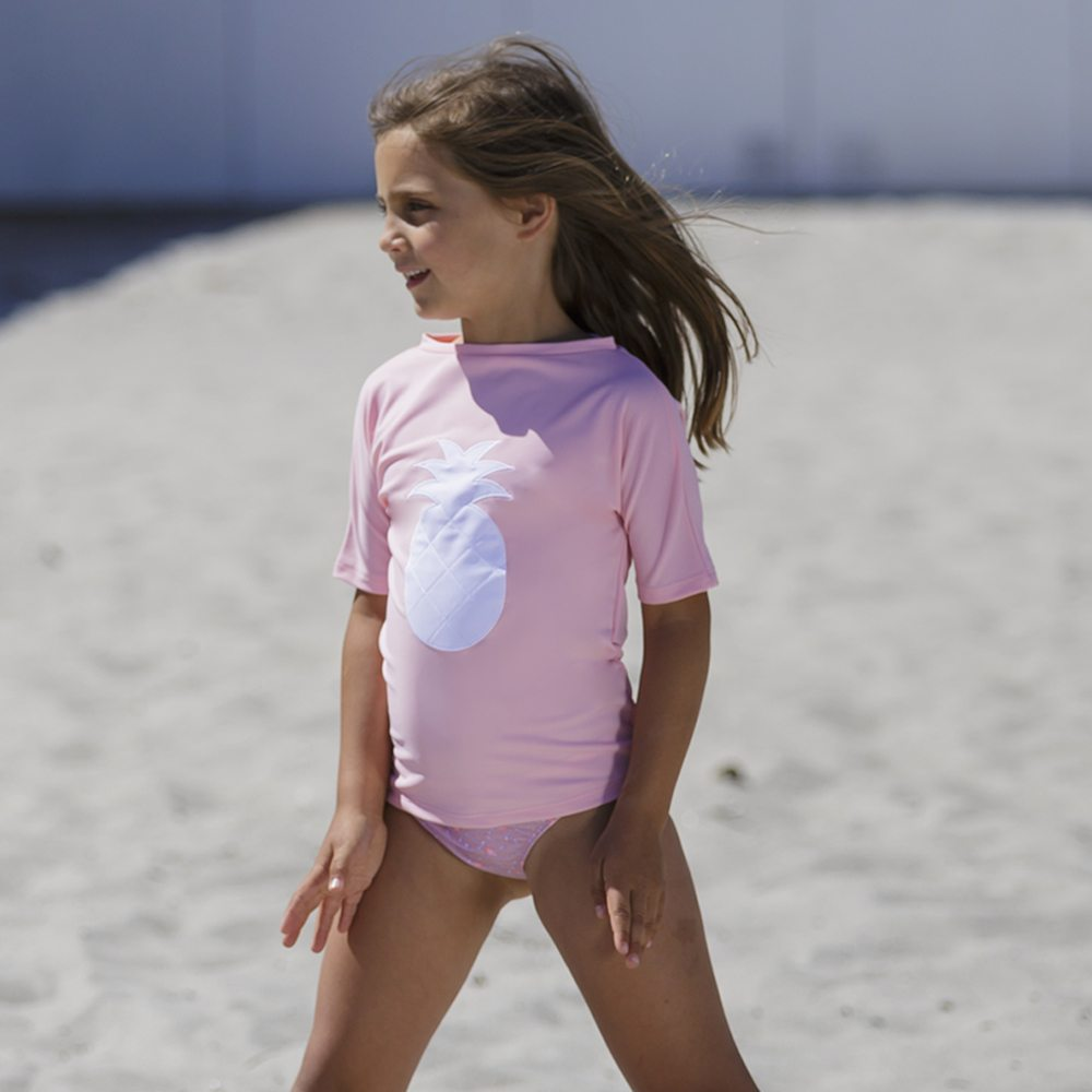 Petit Crabe sun protective rash guard for girls, pineapple uv swim shirt in soft rose
