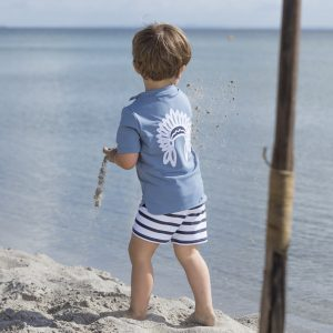 Petit Crabe sun protective swimwear for kids, boy in rash guard Hugo Chief China Collar in petrol blue and stripe swim trunks