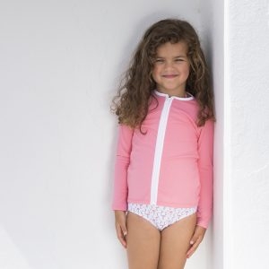 Petit Crabe sun protective swimwear for kids, girl in Etoile Zipper rash guard in watermelon and Flamingo bikini bottoms