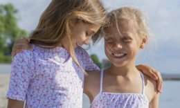Girls In Petit Crabe Flamingo Sunsuit And Swimsuit, Sun Protective Clothing