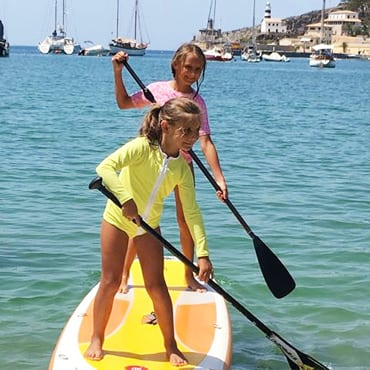 Petit Crabe, girls paddleboarding, Etoile Zipper yellow rash guard, sun protective swim shirts with long sleeves for kids